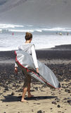 Young man with surf Royalty Free Stock Photo