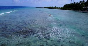 V08002 young man on a surfboard paddleboard with aerial flying drone view in blue clear sea water ocean Stock Photography