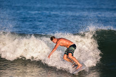 Young Man Surfer Surfing Wave Royalty Free Stock Photography