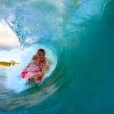 Young man surfing. Youthful young man Boogie Boarding Blue Wave stock photos