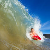 Young man surfing. Youthful young man Boogie Boarding Blue Wave Royalty Free Stock Images