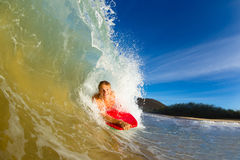 Young man surfing. Youthful young man Boogie Boarding Blue Wave stock image