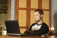 Young man surfing the web. Inside home Royalty Free Stock Images