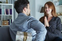 Young man surprise girlfriend with gift Stock Photo