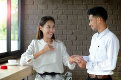 Young man Surprise girlfriend with a marriage proposal. Stock Photos