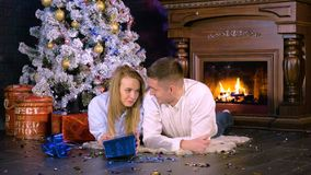 Young man surprise his girlfriend with a Christmas gift at Christmas eve. HD. Young man surprise his girlfriend with a Christmas gift at Christmas eve stock video
