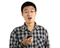 Young man surprise by phone Royalty Free Stock Image