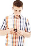 Young man surprise by phone Stock Image