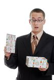 Young man surprised by a christmas present Stock Image