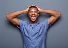 Young man with surprised expression on face Stock Photography