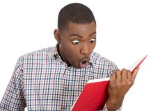 Young man surprised at what he reads Stock Image