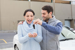 Young man surprising girlfriend with new car Royalty Free Stock Photo