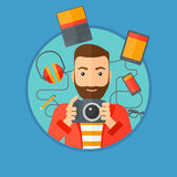 Young man surrounded with his gadgets. Royalty Free Stock Photos