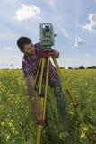 Young Man Surveyor Rapeseed. Selective focus Royalty Free Stock Photos