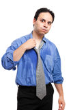 Young man sweating. Young man without air conditioner sweating in the office Stock Photography