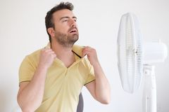 Young man sweating because summer heat haze. Young man suffering from summer heat and high humidity level Stock Photo