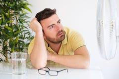 Young man suffering because summer heat haze. Young man sweating because summer heat haze Stock Images