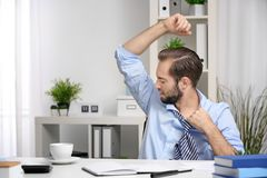 Young man sweating. In office Stock Image