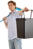 Young man with sweep brush and bucket Royalty Free Stock Image