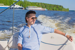 Young man swiming and resting on his yacht at. Young man swiming and resting on his yacht Royalty Free Stock Image