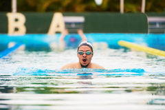 Young man swimmer portrait. In pool water. Exercise activity in pool Royalty Free Stock Photos