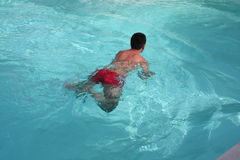 Young Man Swimming stock image