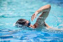 Young man swimming Royalty Free Stock Photos