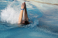 Young man swimming backstroke Royalty Free Stock Image
