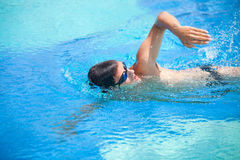 Young man swimming the front crawl/freestyle Stock Images