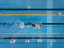 Young man swimming laps in a pool stock images