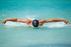 Young man swimming in oceans water Royalty Free Stock Photo