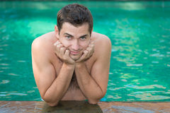 Young man in a swimming pool Stock Photo