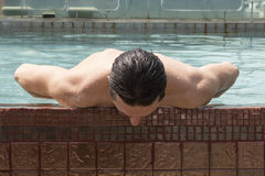 Young man at swimming pool Stock Image