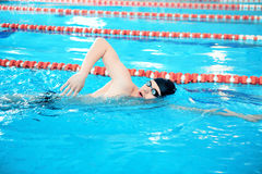 Young man in swimming pool Stock Photography
