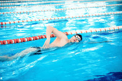 Young man in swimming pool Royalty Free Stock Images