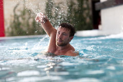 Young Man Swimming In Pool Royalty Free Stock Images
