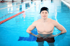 Young man in swimming pool Stock Image