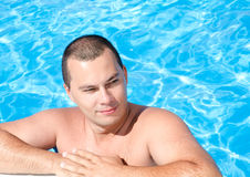 Young man in the swimming pool. Handsome young man in the swimming pool Royalty Free Stock Photos