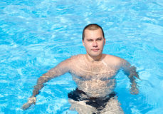 Young man in the swimming pool. Handsome young man in the swimming pool Royalty Free Stock Images