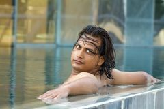 Young man in swimming pool. Portrait of young man in swimming pool Stock Photos