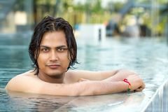 Young man in swimming pool. Portrait of young man in swimming pool Royalty Free Stock Photos