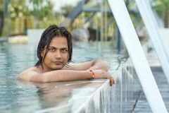 Young man in swimming pool. Portrait of young man in swimming pool Stock Images