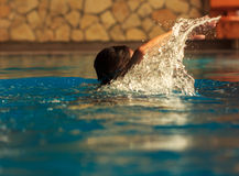 Young man swimming in pool Royalty Free Stock Photo