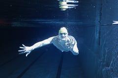 Man in swimming pool. Underwater Stock Image