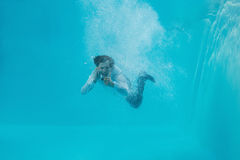 Young man swimming underwater Royalty Free Stock Photo
