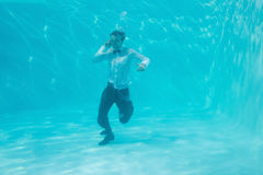 Young man swimming underwater Royalty Free Stock Photography