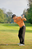 Young man swinging golf club Royalty Free Stock Photography