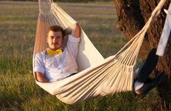 Young man swinging in hammock Stock Photos