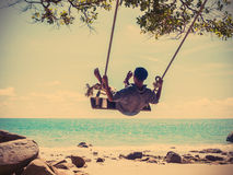 Young man swinging Royalty Free Stock Image
