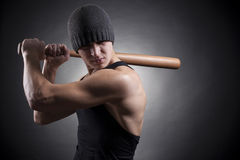Young man swung the bat Stock Photography